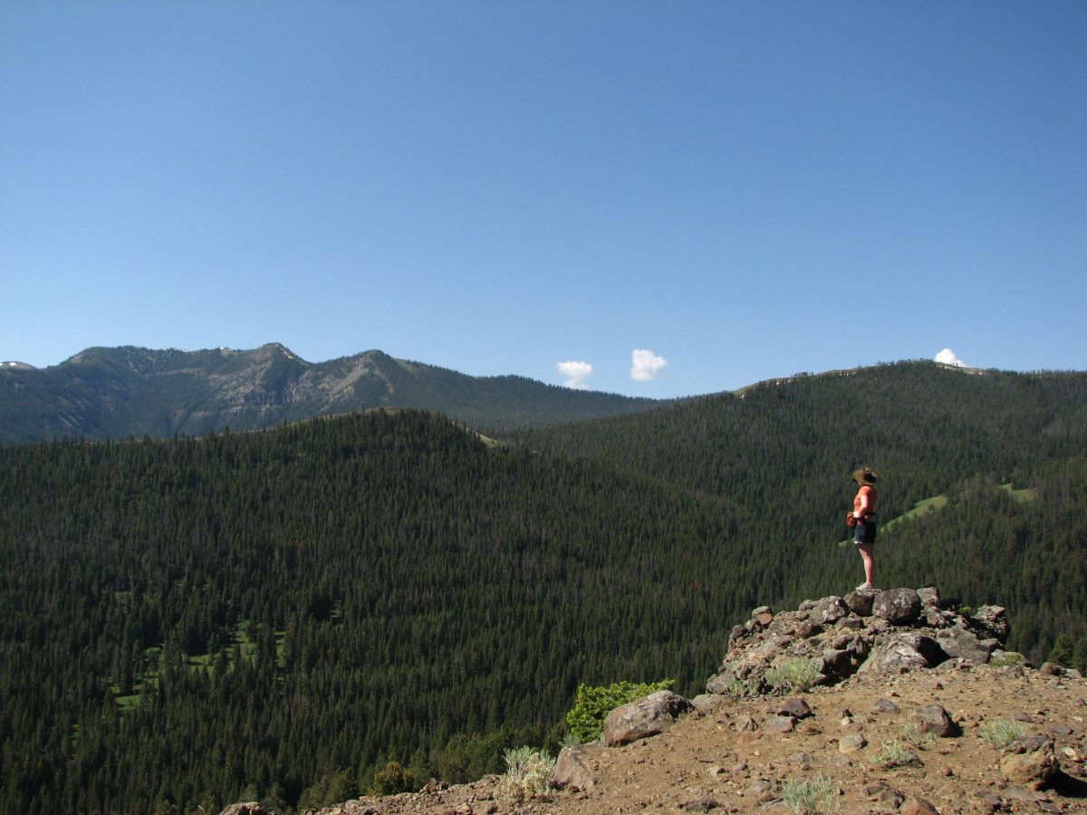 A hiker enjoys a scenic Montana mountain view